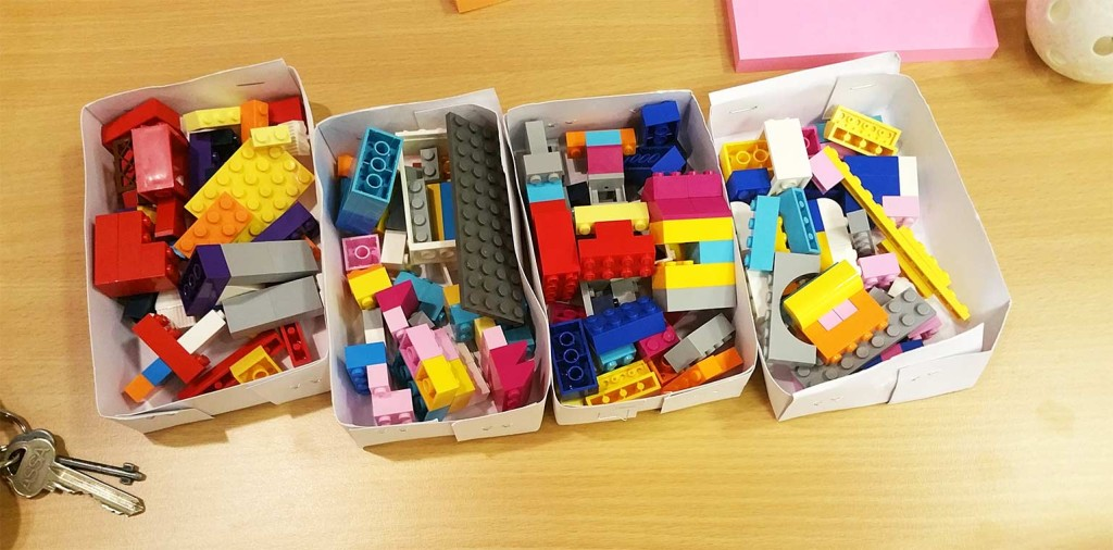 Lego in boxes prepared for 4 teams.